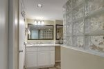 master bedroom with king size bed, ocean views from wall to wall bay windows