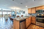 breakfast bar with granite counters, stainless steel appliances, decorative tile back splash