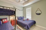 Master bedroom upstairs with king bed and custom bamboo headboard