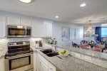 Stainless steel appliances with kitchen amenities