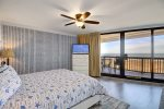 Master suite king bed with cable television and private balcony