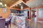 Talavera tile adds a lively texture to the kitchen