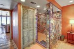 Walk in shower and privacy door to lavatory