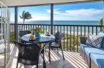 Screened lanai with direct beach view