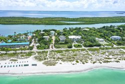 Captiva Tarpon - Luxury bay front home with dock, tennis, beach, gated