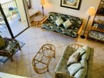 Beautifully decorated and comfortable living room with a lanai overlooking the Fazio Golf Course