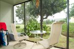Screened in lanai with dining table