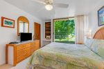 Dining table with golf course views and A/C in living room