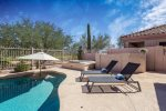 Lounge out by the pool and enjoy the desert views