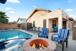 Private backyard with a heated pool, spa, fire pit, and BBQ