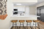 Bar seating for conversations in the kitchen with your morning coffee