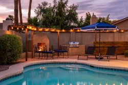 Updated w/ Festive Yard, heated pool, outdoor & indoor fireplace!