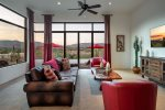 Living room with glass walls to take in all the views