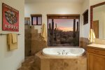 Jetted tub, large walk in shower, and yes.. more views