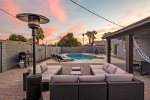 Private yard with heated pool, BBQ, seating, & fire pit