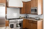 Luxury appliances and fully stocked cabinets
