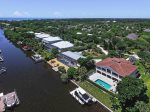 Aerial view of back of home w/boat dock