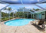 Screened in lanai with pool and hot tub