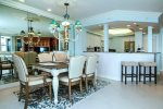 Dining area, breakfast bar, and kitchen