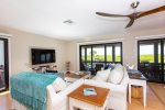 Open living room with access to lanai