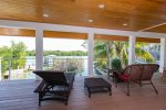 Main floor covered veranda overlooking waterfront