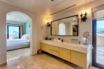 Beautiful en suite master bedroom with shower and tub, large walk in closet and fully stocked