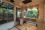High ceilings, exposed beams, small living area with ocean views. Mike Doyle paintings