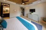King master bedroom with access to private balcony.