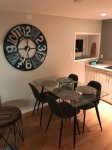 Dining table with decorative wall clock