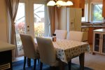 Dining table with French doors to the patio