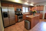 This spacious kitchen is equipped with modern and energy efficient stainless steel appliances