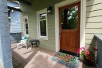 Cute and colorful front porch with seating area
