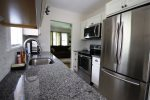 The kitchen is immaculate - all new stainless steel appliances and granite counter tops.