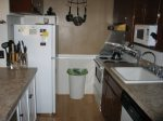 The galley style kitchen comes equipped with all your household needs.