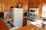 Rather small, but fully equipped kitchen, ample cupboard space.