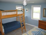 Bedroom 3 with queen bed and twin bunk set.