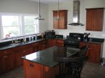 A chef`s dream kitchen, with gorgeous counter tops, 6 burner gas stove, and high end appliances.