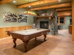 On the lower level - Pool table with see through fireplace to additional game room and bar.
