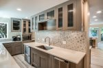 Soak in this hot tub with views of Lake Pend Oreille and Schweitzer Mtn.
