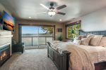 2nd master bedroom has King bed, luxury linens, fireplace and private waterfront deck.