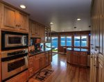 Large kitchen with gas cooktop is fully appointed.