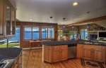 Granite countertops in this amazing kitchen with lake views.