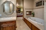 Master bath has shower, 2 sinks, jacuzzi tub, and gas fireplace.