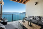 Private deck offers sweeping views.  Marina slip included.