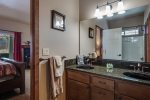 Master bath has 2 sinks and shower-tub combination