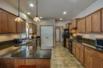 Great open kitchen is fully appointed with all dishes, bakeware, etc.