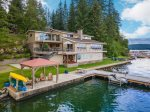FLAT Waterfront family home with dock, yard, fire pit, boat lift & more!