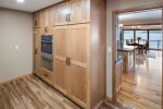 Butler`s pantry off kitchen with high capacity washer & dryer.