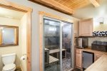 Large steam room and 1/2 bath, plus additional pantry area behind kitchen.