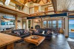 Wood burning fireplace, slate floors, huge beams in this Great Room.